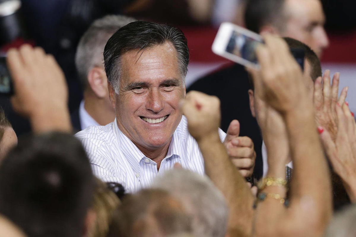 Republican presidential candidate, former Massachusetts Gov. Mitt Romney greets supporters after speaking at a rally Friday, Sept. 21, 2012, in Las Vegas. Romney campaigned in Nevada as aides released a 2011 federal income tax return showing he and his wi