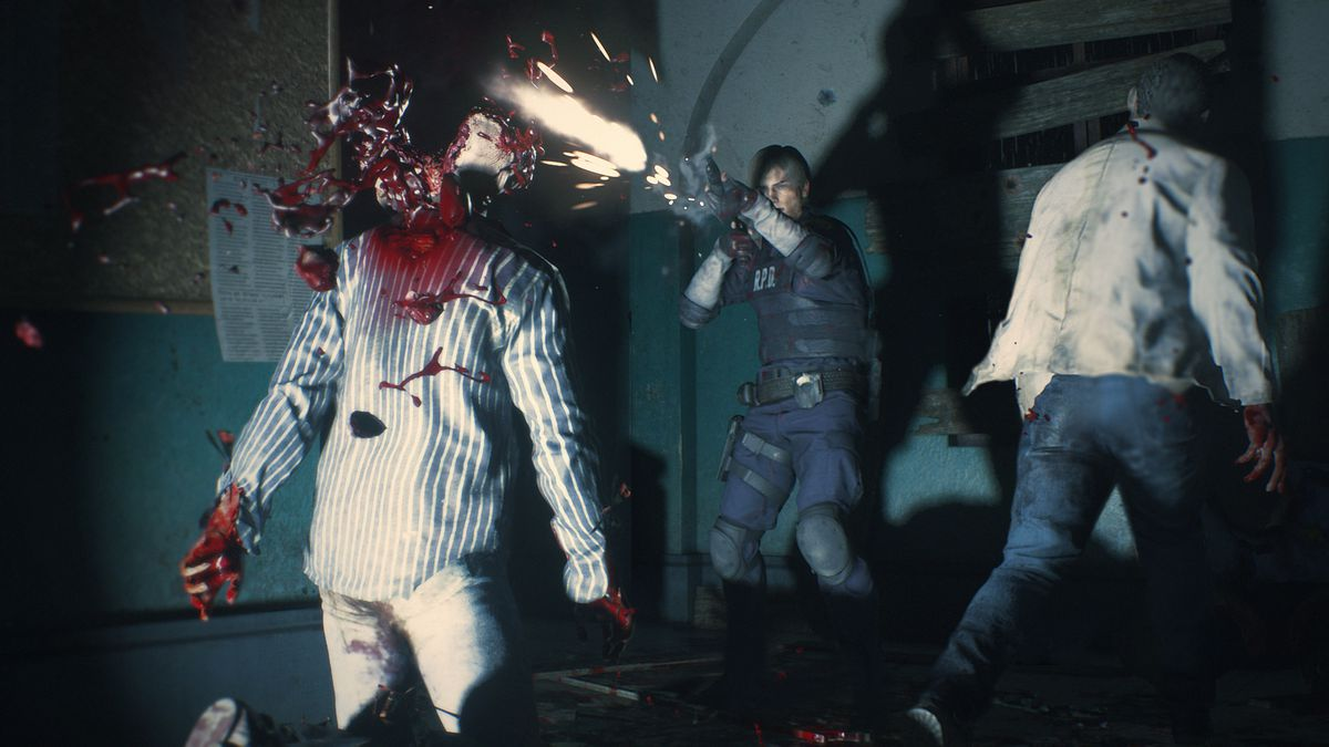 Leon S. Kennedy fires a shotgun blast at a zombie's head in a screenshot from the Resident Evil 2 remake.