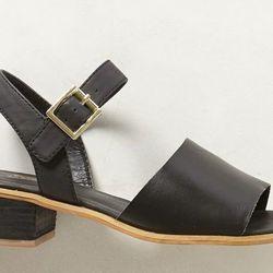 "<b>Soles Future Told</b> Johanna Sandal in Black, <a href=""http://www.anthropologie.com/anthro/product/shoes-sandals/30585970.jsp?cm_sp=Grid-_-30585970-_-Regular_83#/"">$128</a>"