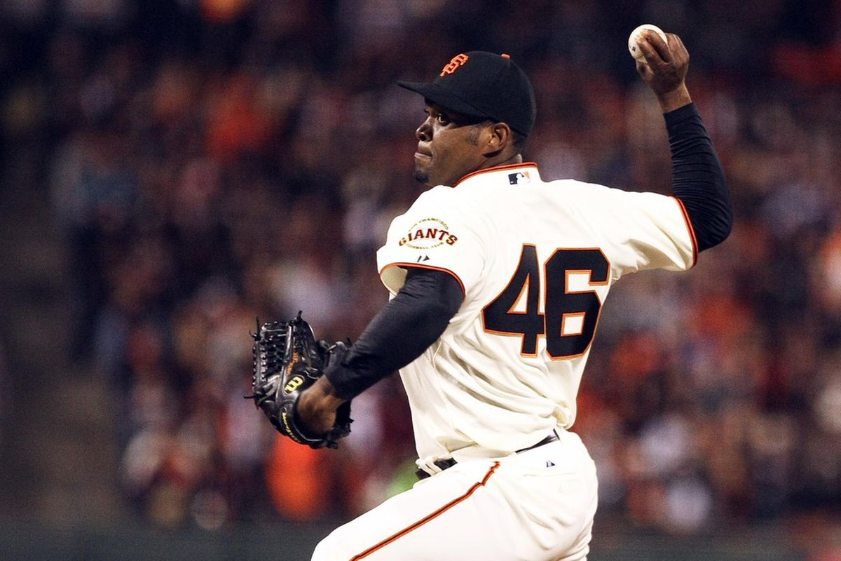 April 14, 2012; San Francisco CA, USA; San Francisco Giants relief pitcher Santiago Casilla (46) throws a pitch against the Pittsburgh Pirates during the eighth inning at AT&T Park. Mandatory Credit: Kelley L Cox-US PRESSWIRE