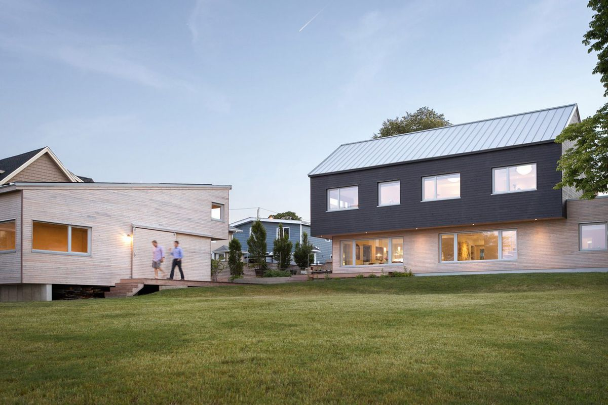 Modern home offers cantilevers and energy efficient design for Modern new england home plans