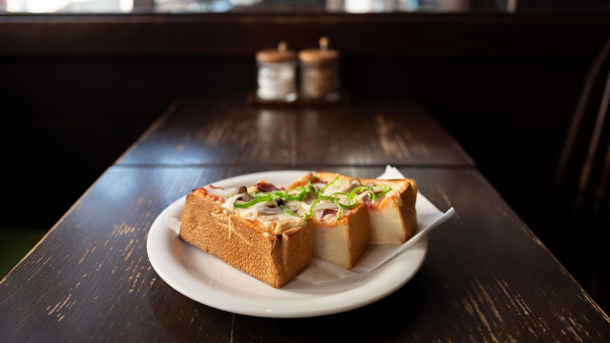 A piece of pizza toast cut into thirds on a table