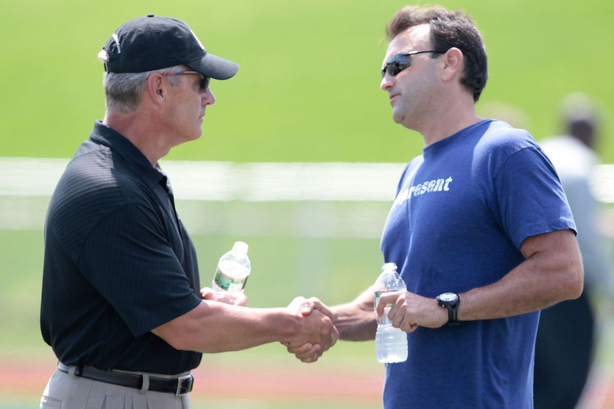 Agent Drew Rosenahus shakes hands with former Ohio State football head coach Jim Tressel following Terrelle Pryor's pro day at a practice facility on August 20, 2011 in Pennsylvania.  (Photo by Jared Wickerham/Getty Images)