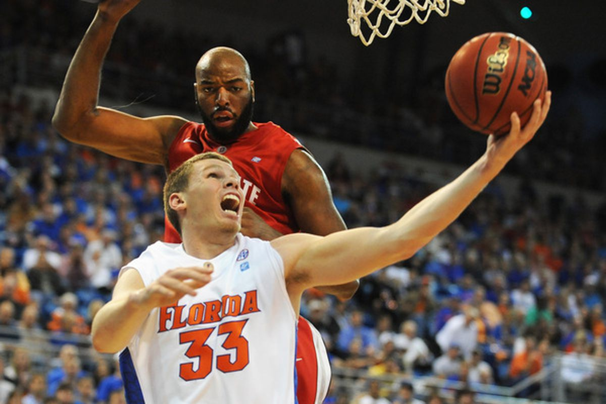 GAINESVILLE FL - NOVEMBER 16: Guard Jon Diebler #33 of the Ohio State Buckeyes scores under the basket against the Florida Gators November 16 2010 at the Stephen C. O'Connell Center in Gainesville Florida.  (Photo by Al Messerschmidt/Getty Images)