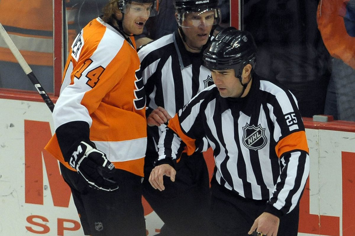 """Sean Couturier reacts in astonishment as referee Marc Joannette performs an original dance he calls """"the Robot""""."""