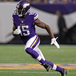 Aug 9, 2013; Minneapolis, MN, USA; Minnesota Vikings wide receiver Greg Jennings (15) runs a route during the first quarter against the Houston Texans at the Metrodome.
