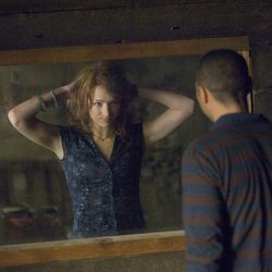 """In this film image released by Lionsgate, Kristen Connolly and Jesse Williams are shown in a scene from """"The Cabin in the Woods."""""""