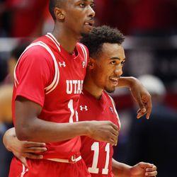 Utah Utes forward Dakarai Tucker (14) and Utah Utes guard Brandon Taylor (11) walk off the floor at a timeout as Utah and BYU play in the Huntsman Center in Salt Lake City Wednesday, Dec. 2, 2015. Utah won 83-75.