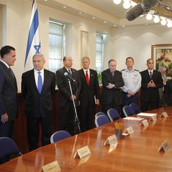 FILE - In this Sunday, July 29, 2012 file photo, Republican presidential candidate and former Massachusetts Gov. Mitt Romney, left, meets with Israel's Prime Minister Benjamin Netanyahu, second left, at his office in Jerusalem.  It is a taboo for Israeli leaders to give even the slightest hint of favoritism in politics in the United States, Israel's closest ally. So some Israelis are squirming over a perception that Prime Minister Benjamin Netanyahu is siding with Republican Mitt Romney in the U.S. presidential race, in the belief he would take a harder line on archenemy Iran. That, some fear, is putting Israel?s alliance with Washington at risk if Barack Obama wins. (AP Photo/Charles Dharapak)