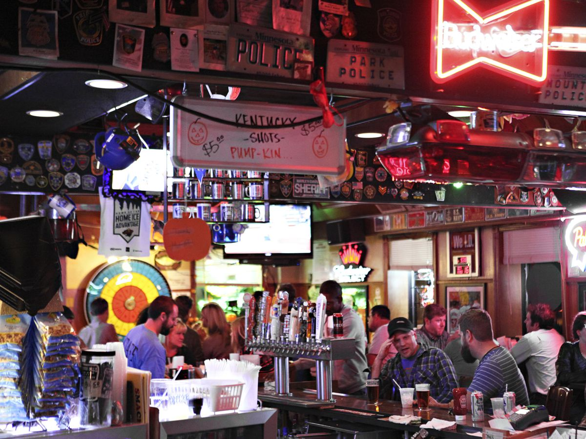 A busy, old bar full of tchotchkes and beer signs