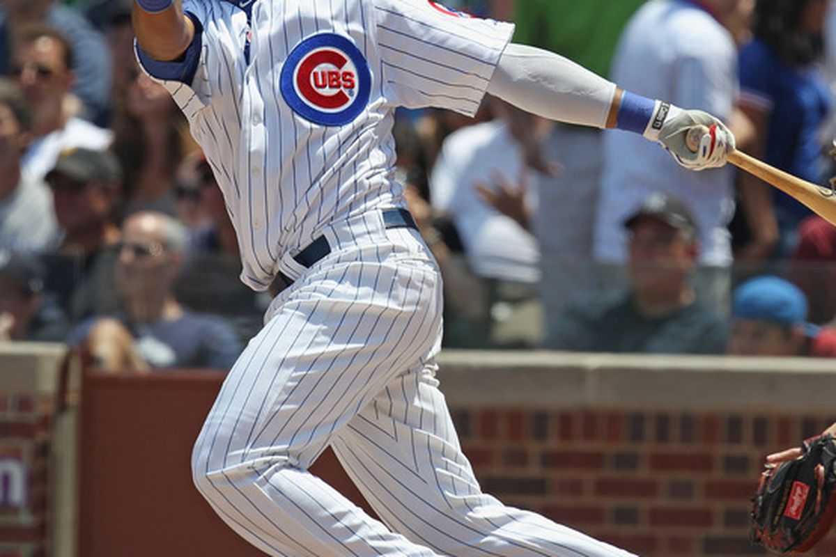 Starlin Castro of the Chicago Cubs hits a run scoring double in the 1st inning against the New York Yankees at Wrigley Field on June 17, 2011 in Chicago, Illinois. The Cubs defeated the Yankees 3-1. (Photo by Jonathan Daniel/Getty Images)
