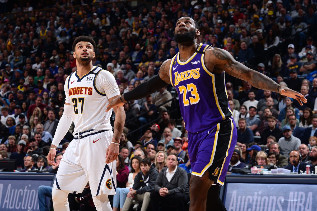 Jamal Murray of the Denver Nuggets and LeBron James of the Los Angeles Lakers fights for position to grab the rebound on February 12, 2020 at the Pepsi Center in Denver, Colorado.