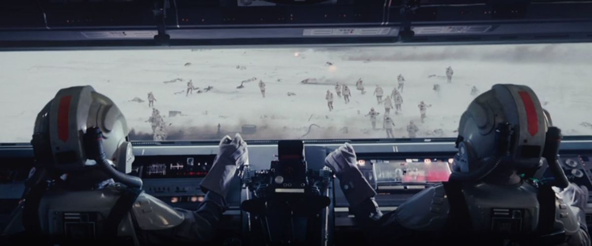 Two AT-AT pilots at the controls of a massive AT-AT walker.