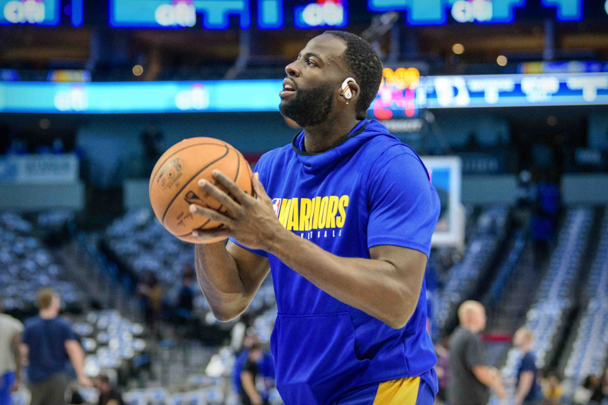 Golden State Warriors forward Draymond Green warms up before the game against the Dallas Mavericks at the American Airlines Center.