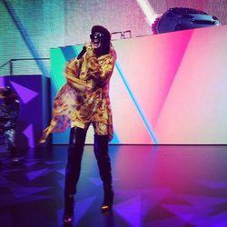 "M.I.A. (wearing Jeremy Scott) performing ""Bad Girls"" as Jeremy Scott's Smart car emerges"