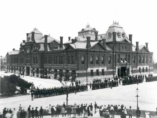 Pullman strikers outside Arcade Building in Pullman, Chicago, in 1894. The Illinois National Guard can be seen guarding the building during the Pullman Railroad Strike.