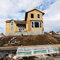 Construction crews work on a new home in Daybreak on Friday, Feb. 3, 2017. According to the 2017 Salt Lake Housing Forecast report released on Friday by the Salt Lake Board of Realtors, the Salt Lake County real estate market in 2016 had its best year in a decade.