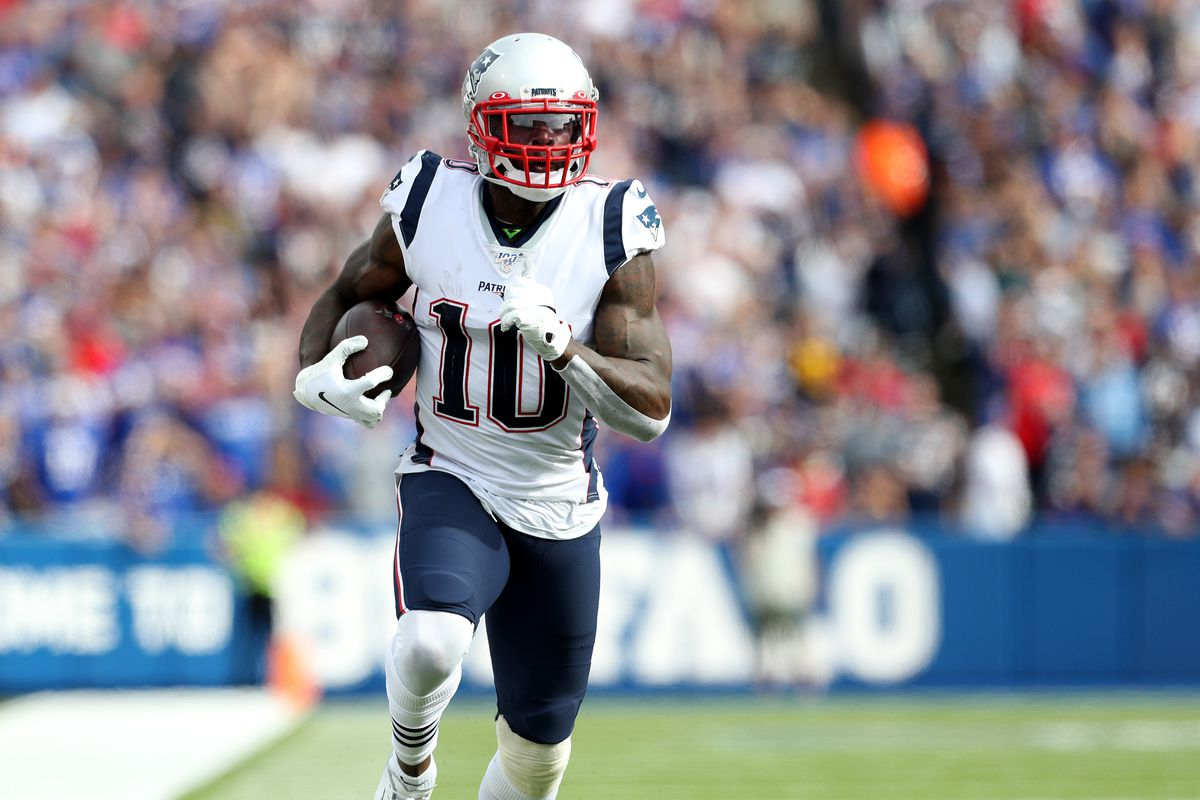 Josh Gordon of the New England Patriots runs with the ball during the third quarter of a game against the Buffalo Bills at New Era Field on September 29, 2019 in Orchard Park, New York.