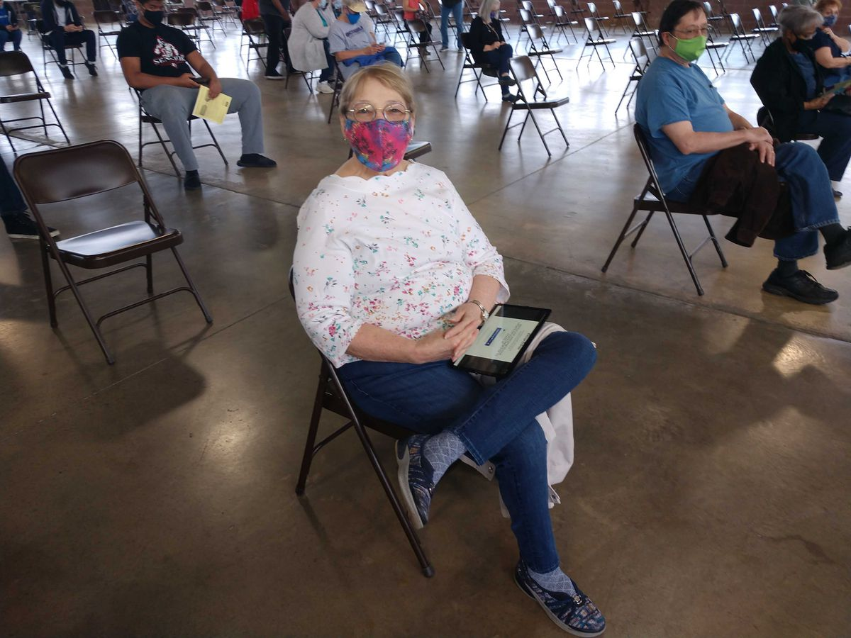 Retired nurse Phyllis Jones rests after receiving a dose of the coronavirus vaccine at the Illinois State Fairgrounds on Wednesday.