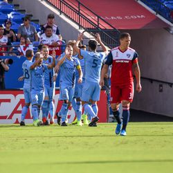 New York City FC players celebrate their only goal of the match in the first half of the match against FC Dallas.