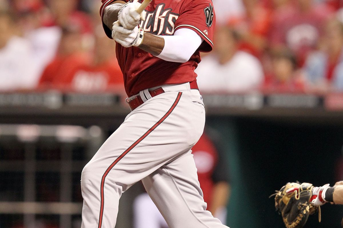 CINCINNATI, OH - JULY 18:  Justin Upton #10 of the Arizona Diamondbacks swings at a pitch during the game against the Cincinnati Reds at Great American Ball Park on July 18, 2012 in Cincinnati, Ohio.  (Photo by Andy Lyons/Getty Images)