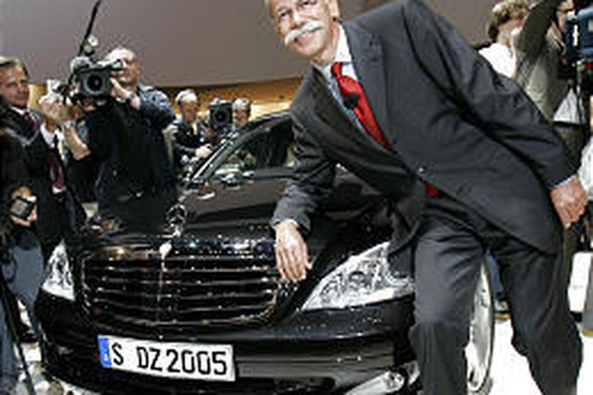 Dieter Zetsche, next CEO of DaimlerChrysler, shows off new S-Class Mercedes in Frankfurt Monday.