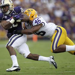 Washington running back Bishop Sankey (25) tries to break a tackle by LSU linebacker Kevin Minter (46) during the first half of an NCAA college football game in Baton Rouge, La., Saturday, Sept. 8, 2012.