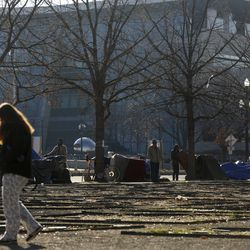 Homeless people pack up their camps following a chilly night in front of the Salt Lake Main Library in Salt Lake City on Sunday, Nov. 24, 2019.