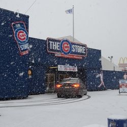 1:40 p.m. Car drove up on sidewalk behind me, and drives up to Cubs Store entrance -