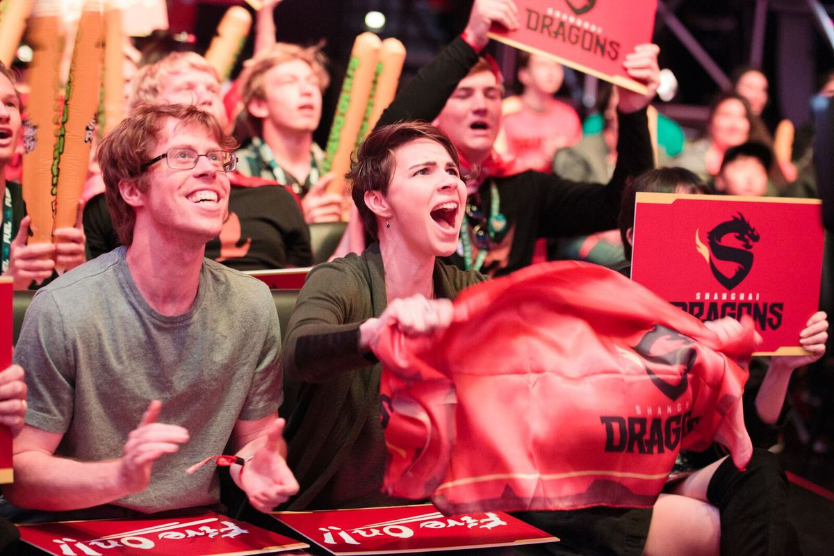 Fans at the Blizzard Arena cheer for the Shanghai Dragons