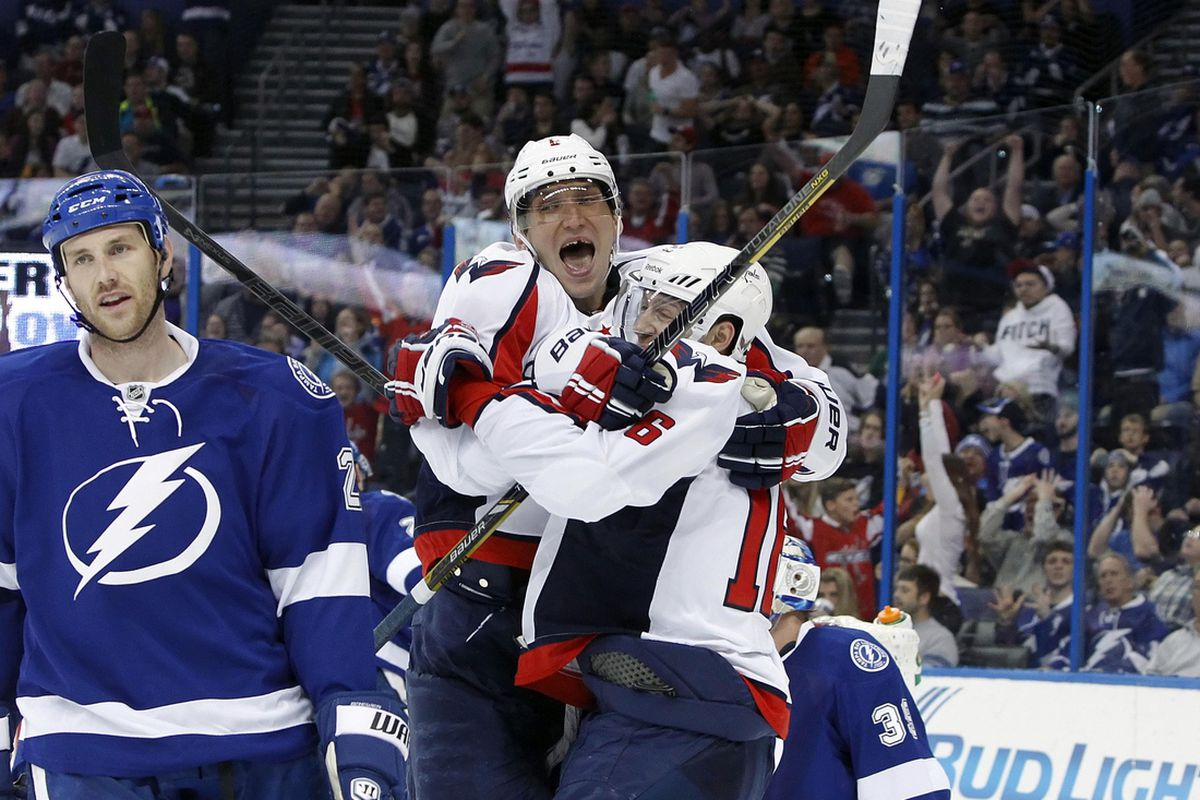 Alex Ovechkin and Eric Fehr celebrate after Fehr's game-winning goal over the Tampa Bay Lightning Thursday night.