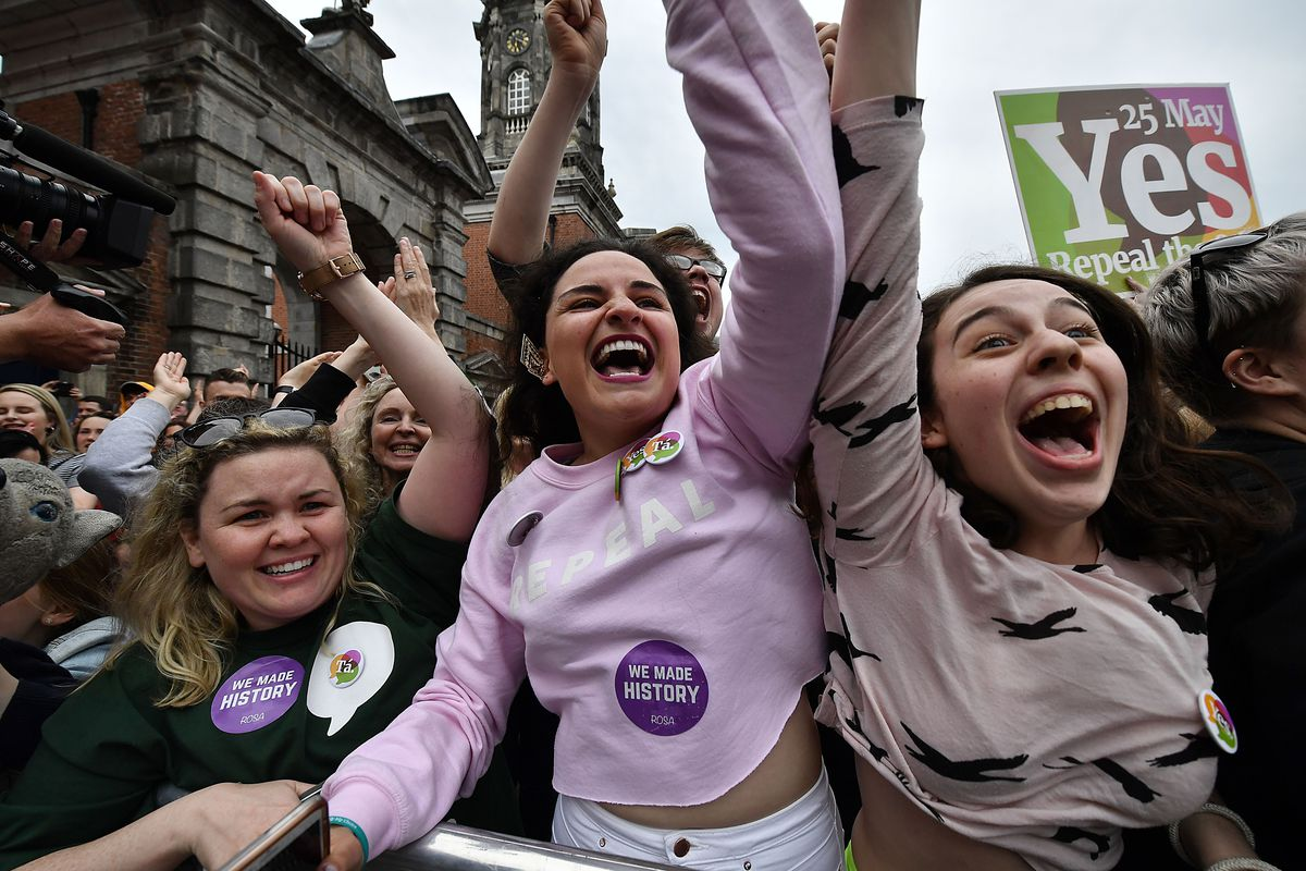 """Yes"" voters celebrate as the result of the Irish referendum on the 8th amendment concerning the country's abortion laws is declared at Dublin Castle on May 26, 2018, in Dublin, Ireland."