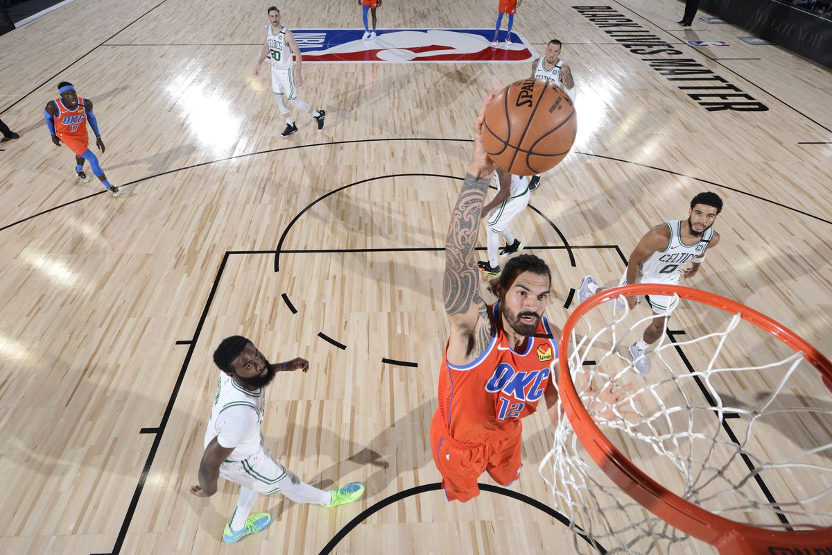 Steven Adams of the Oklahoma City Thunder dunks the ball against the Boston Celtics on July 24, 2020 at Visa Athletic Center at ESPN Wide World of Sports Complex in Orlando, Florida.