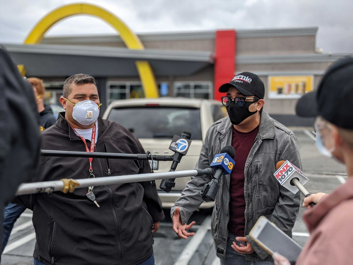 McDonald's protesters being interviewed by the media in South LA on April 6