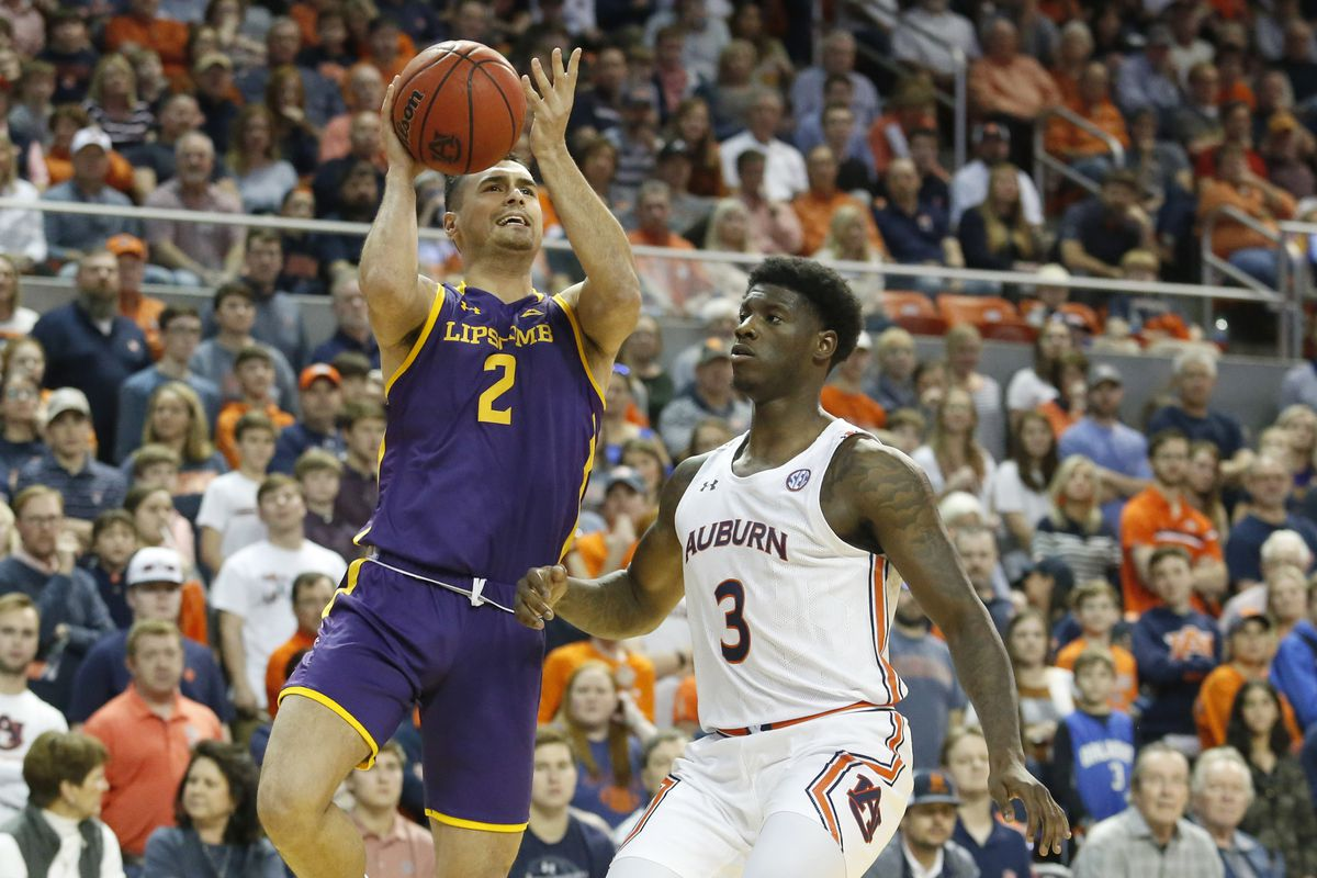 Lipscomb Bisons guard Andrew Fleming takes a shot as Auburn Tigers forward Danjel Purifoy defends during the first half at Auburn Arena.
