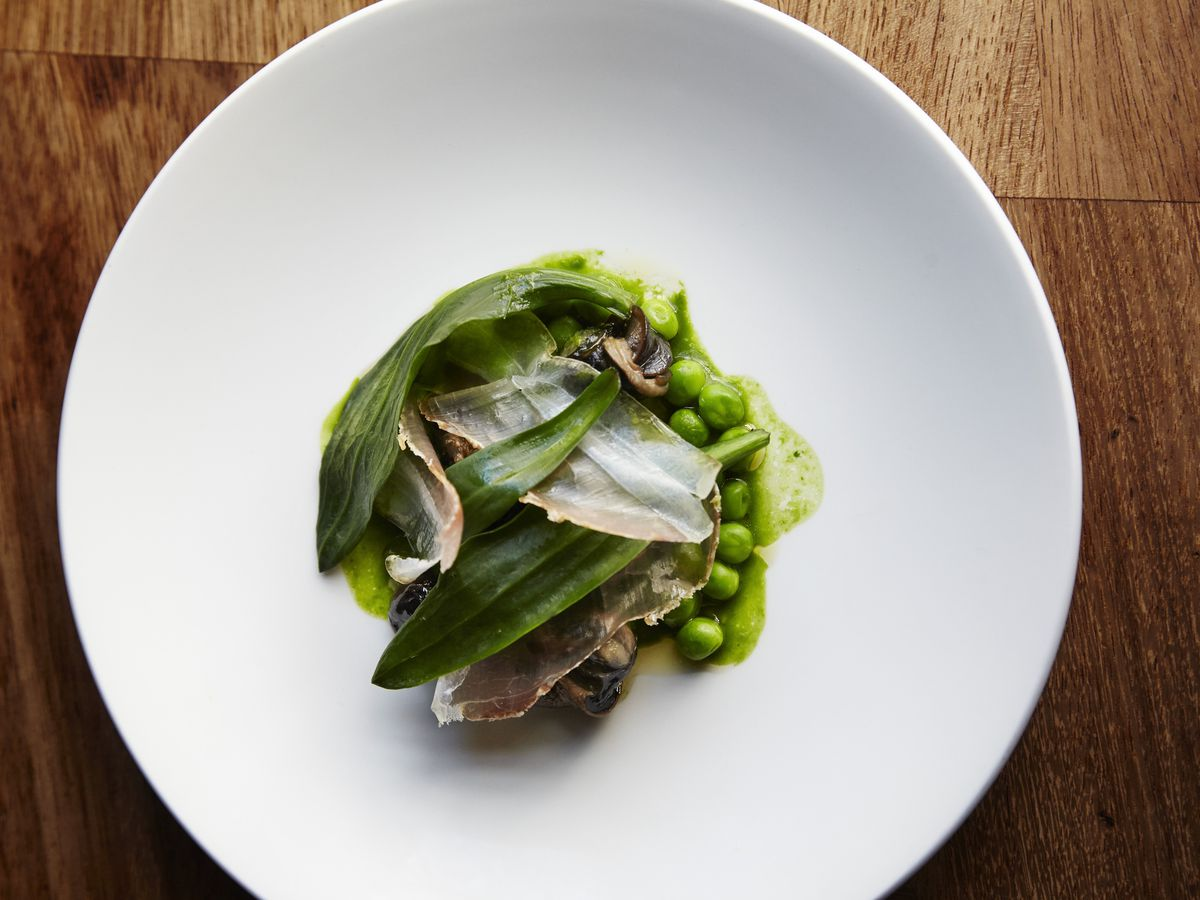 Peas, wild garlic and lardo at The Marksman on Hackney Road, the pub and dining roomthat forms part of the best 24 hour restaurant travel itinerary for London — where to eat with one day in the city