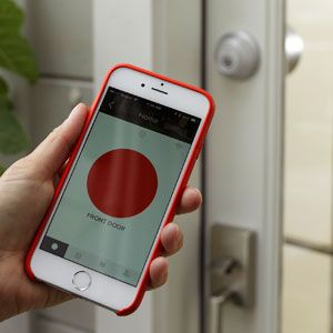 """<p>The <a href=""""http://www.august.com/"""" target=""""_blank"""">August Smart Lock</a> in use.</p>"""