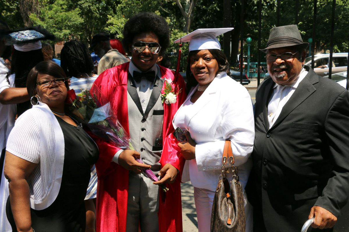 Class of 2016 graduate Langston Rowlings with his family. Photo credit: Patrick Wall