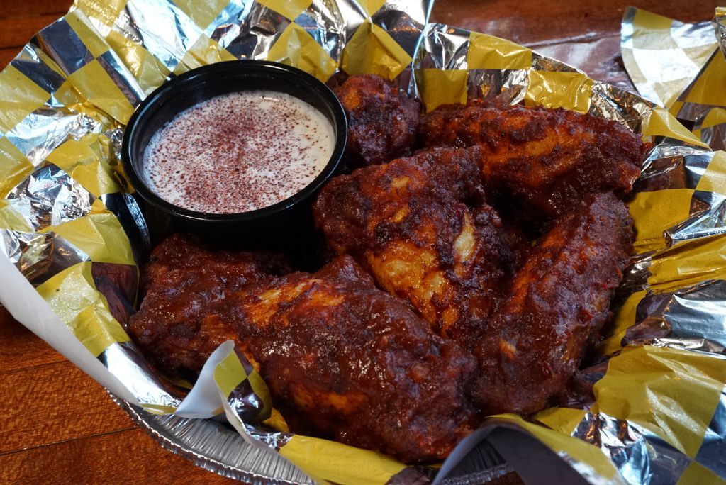 Harissa Demon Wings, served at DMen Tap, tossed with house North African Harissa sauce.