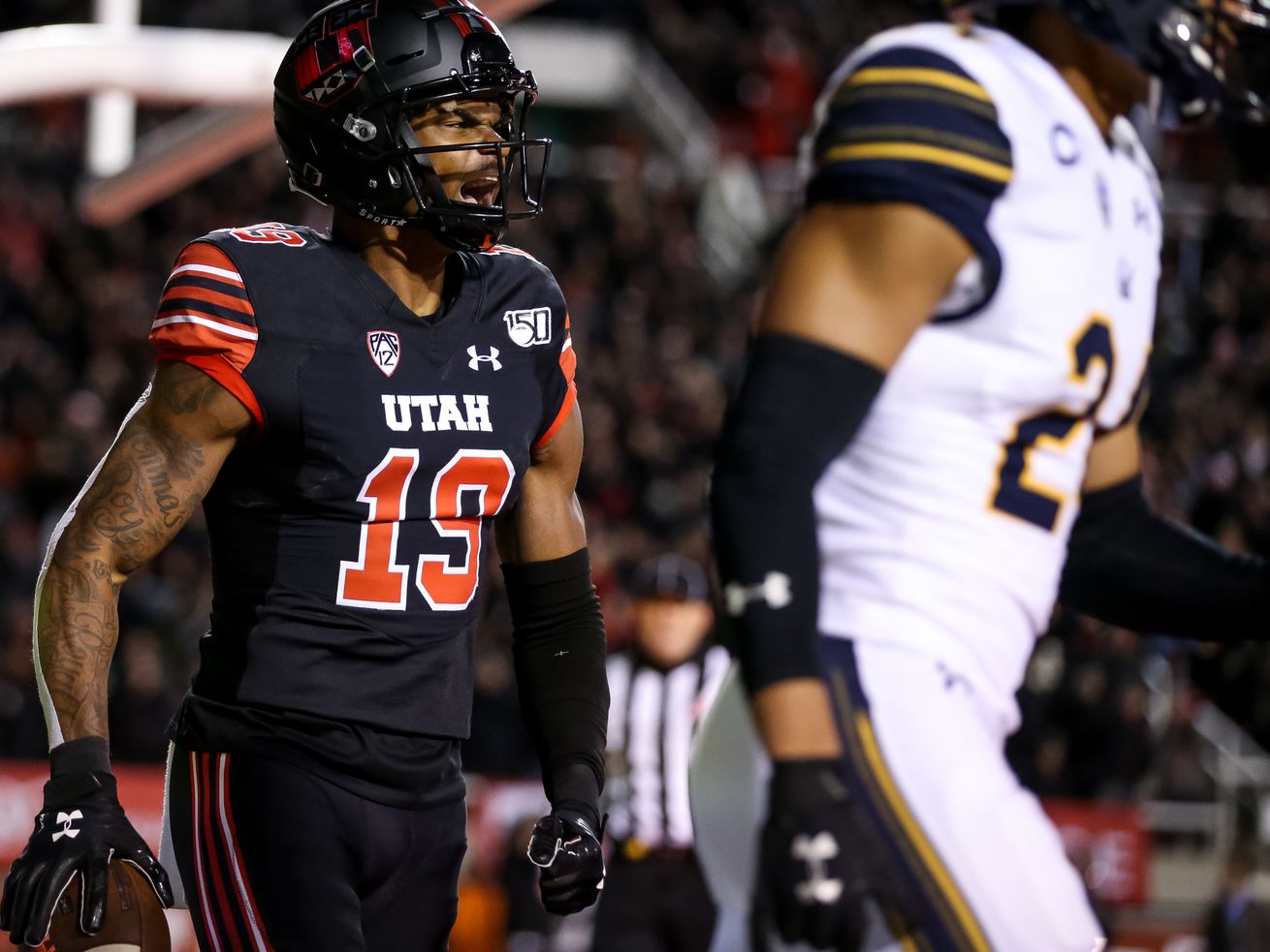 Utah Utes wide receiver Bryan Thompson (19) celebrates after scoring a touchdown on a 40-yard pass from quarterback Tyler Huntley (1), putting the Utes up 14-0 after the PAT, during the game against the California Golden Bears at Rice-Eccles Stadium in Salt Lake City on Saturday, Oct. 26, 2019.