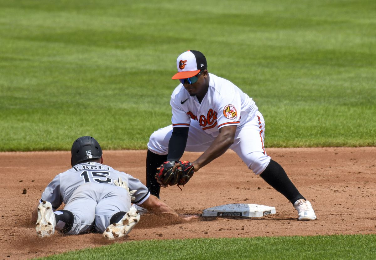 Chicago White Sox center fielder Adam Engel (15) is picked off of second base as the tag is applied by Baltimore Orioles second baseman Domingo Leyba (75) during the Chicago White Sox game versus the Baltimore Orioles on July 11, 2021 at Orioles Park at Camden Yards