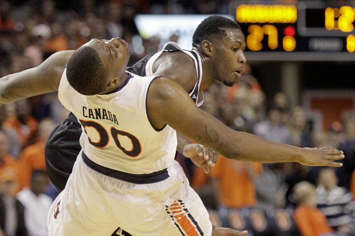 Akeem Springs is fouled by Malcom Canada as Milwaukee loses to Auburn