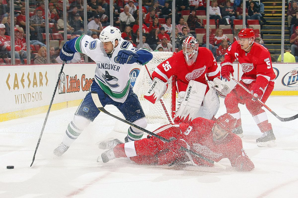 Place your finger right where the Wings player's leg is. It looks like Marco Sturm's foot has been taken off.
