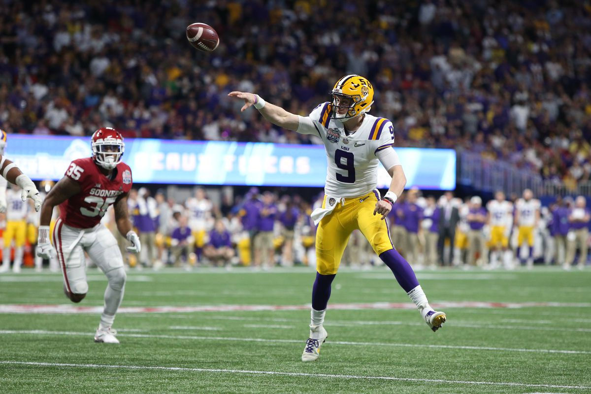 LSU Tigers quarterback Joe Burrow throws a pass against the Oklahoma Sooners during the first quarter of the 2019 Peach Bowl college football playoff semifinal game.