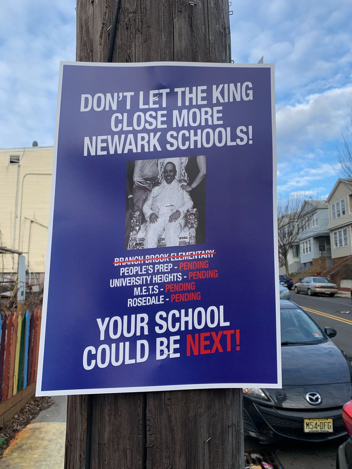One of the posters that has appeared across the city attacking Superintendent León's recommendation that the state close four Newark charter schools.