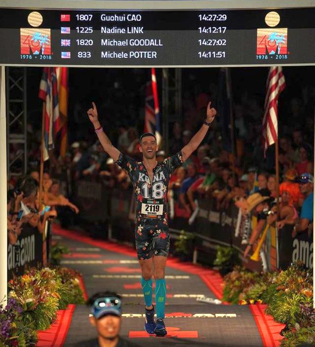 Michael Lalli about to cross the finish line at Kona in 2018.