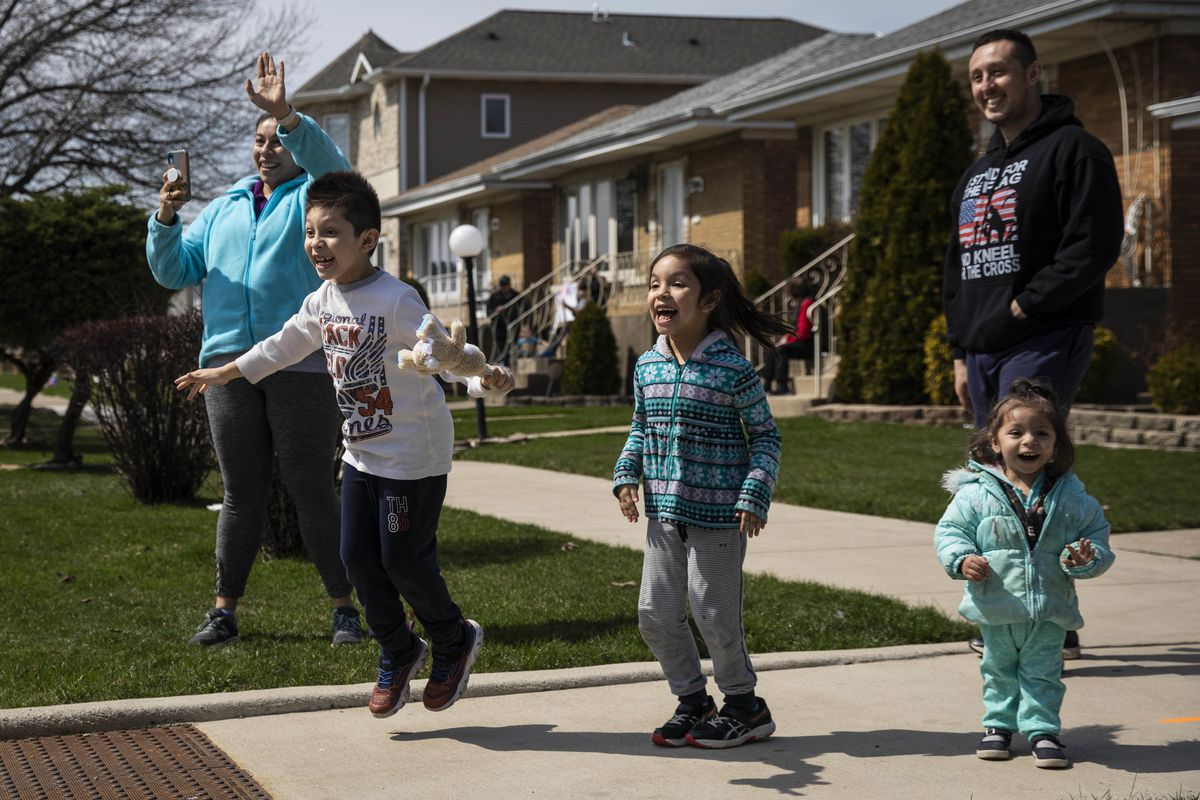 Classes have given way to e-learning, but this family was thrilled to see teachers and other staffers of John C. Dore Elementary School parade around the neighborhood on the Southwest Side to connect with the kids they can't see for now and their families.