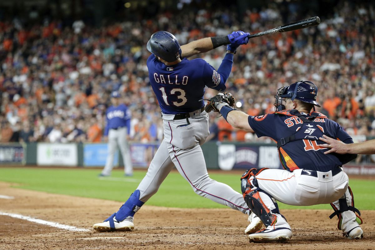 Joey Gallo of the Texas Rangers strikes out in the eighth inning against the Houston Astros at Minute Maid Park on July 21, 2019 in Houston, Texas.