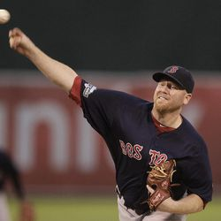 Boston Red Sox's Aaron Cook works against the Oakland Athletics in the first inning of a baseball game Friday, Aug. 31, 2012, in Oakland, Calif.