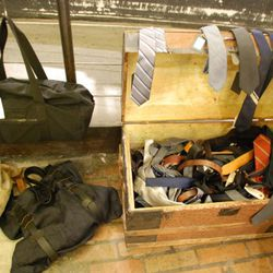 Men's bags and a chest full of ties